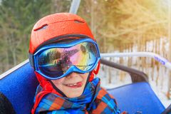 Portrait of Cute skier boy in a winter ski resort. stock photography