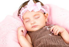 Portrait of a cute sleeping baby girl. Isolated on white background Royalty Free Stock Photo