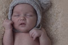 Portrait of a sleeping newborn baby in hat Royalty Free Stock Photos