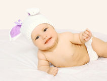 Portrait of cute smiling baby in hat on the bed Royalty Free Stock Photos