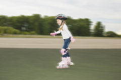 Portrait of cute smiling blond girl skating Stock Photography