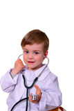 Portrait of cute smiling boy playing a doctor. Isolated over white. Stock Image