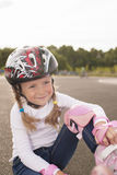 Portrait of cute smiling caucasian girl on rollers Stock Images