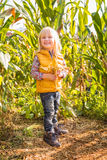 Portrait of cute smiling child in the corn field on farm Stock Photo