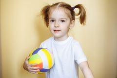 Portrait of cute smiling girl with ball.  stock image