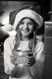 Portrait of cute smiling girl holding Christmas gift box Royalty Free Stock Photos