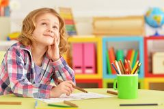 Portrait of cute smiling girl posing and drawing at home. Cute smiling girl posing and drawing at home stock photos