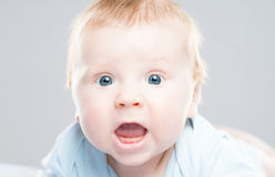 Portrait of a cute smiling infant baby. Happy childhood concept Stock Image