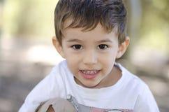 Portrait cute smiling latino boy stock photography