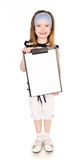 Portrait of cute smiling little girl with clipboard isolated Stock Image
