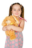Portrait of cute smiling little girl with toy Royalty Free Stock Images