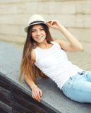 Portrait of cute smiling pretty woman wearing a summer straw hat Royalty Free Stock Image