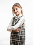 Portrait of cute smiling schoolgirl with pencil behind ear Stock Images