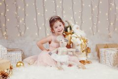 Caucasian girl celebrating Christmas or New Year. Portrait of cute smiling white Caucasian girl celebrating Christmas or New Year. Little adorable cute child Royalty Free Stock Photos