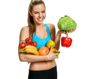 Portrait of cute smiling woman with fresh fruits and vegetables, organic food, health and beauty care concept Stock Photos