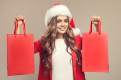 Portrait of cute smiling woman in santa hat. Royalty Free Stock Photos