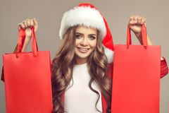 Portrait of cute smiling woman in santa hat. Royalty Free Stock Photo