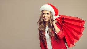 Portrait of cute smiling woman in santa hat. Stock Photos