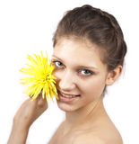 Portrait of cute smiling woman with yellow flower. On a white background stock photo