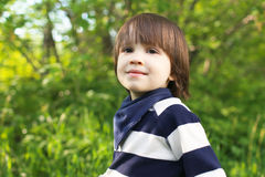 Portrait of cute smiling 2 years child outdoors in summer Stock Photo