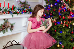 Portrait of a cute smiling young girl in a pink dress, looking a royalty free stock images
