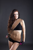 Portrait of cute sporty woman posing with belt Royalty Free Stock Photography