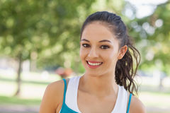 Portrait of cute sporty woman posing in a park Stock Photo