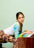 Portrait of cute teen girl. And piano Royalty Free Stock Photos