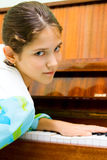 Portrait of cute teen girl. And piano Stock Image