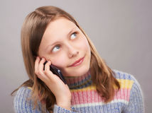 Portrait of a cute teen girl with phone Royalty Free Stock Photos