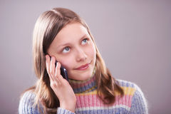 Portrait of a cute teen girl with phone Royalty Free Stock Photo