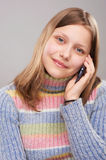 Portrait of a cute teen girl with phone. Studio shot Royalty Free Stock Photos