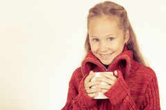 Portrait of a cute teen girl in red sweater holding a mug  Stock Photos