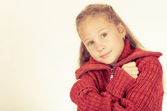 Portrait of a cute teen girl in red sweater Stock Photos