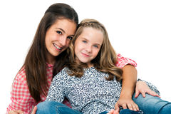 Portrait of cute teen girl with younger sister. Stock Image
