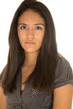 Portrait of cute teen Hispanic girl serious expression Royalty Free Stock Photos