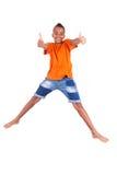 Portrait of a cute teenage black boy jumping Stock Image