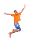 Portrait of a cute teenage black boy jumping Royalty Free Stock Images