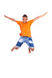 Portrait of a cute teenage black boy jumping Stock Images