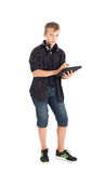 Portrait of a cute teenage boy with headphones and tablet computer. Stock Photo