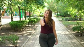 Portrait of cute teenage girl with excess weight in the city Park in the summer. Portrait of a cute teenage girl with excess weight in the city Park in the stock video