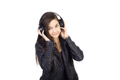 Portrait of cute  teenage girl  with headphones  listening music Royalty Free Stock Images