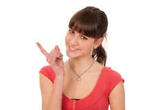 Portrait of cute teenage girl showing naughty sign Stock Photos