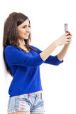 Portrait of cute teenage girl taking self portrait with her smar Royalty Free Stock Photos