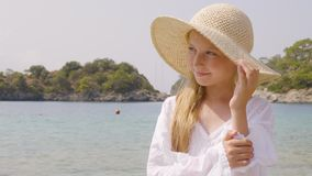 Portrait cute teenager girl in straw hat on blue sea background. at summer vaction. Beautiful girl teenager posing on stock footage