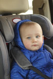 Portrait of cute toddler boy sitting in car seat. Child transportation safety stock images