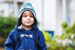 Portrait of cute toddler boy smiling on cold winter day. Royalty Free Stock Images