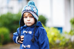 Portrait of cute toddler boy smiling on cold winter day. Royalty Free Stock Image