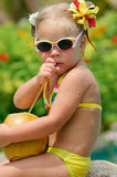 Portrait of cute toddler girl with coconut Royalty Free Stock Image