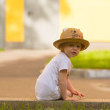 Portrait of a Cute Toddler girl in a funny hat Stock Image